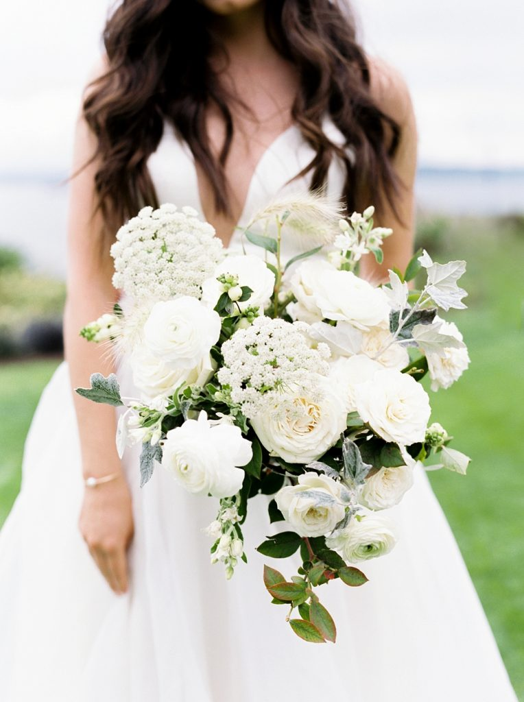 Luxury Destination Wedding Photographer, bride holding bouquet of white flowers and greenery