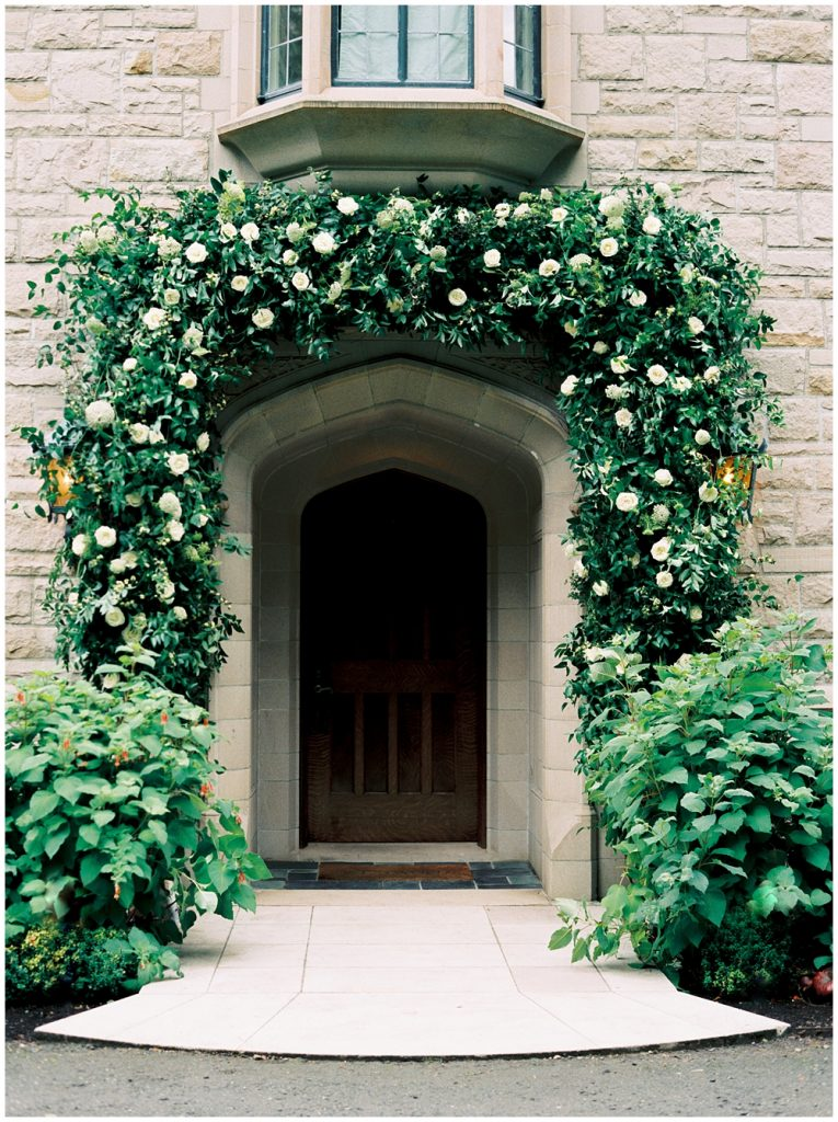 Floral arch over the entrance of the private estate overlooking the Puget Sound