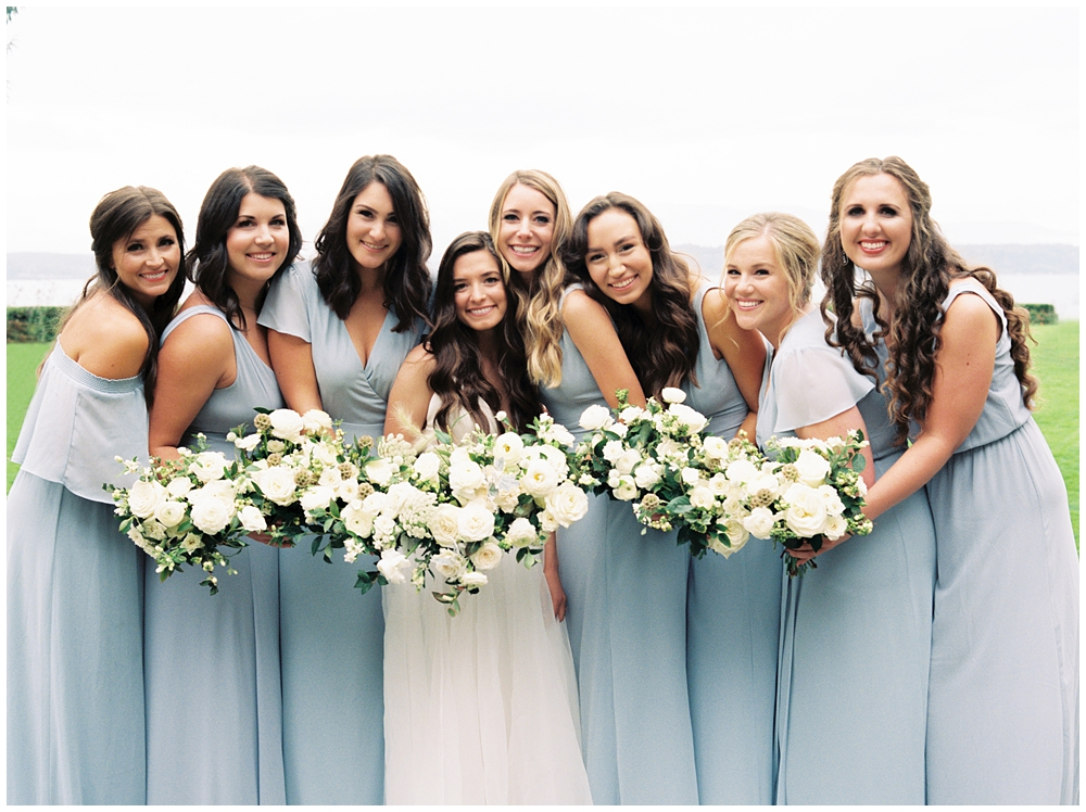bridesmaids portrait grouped closely together holding bouquets up