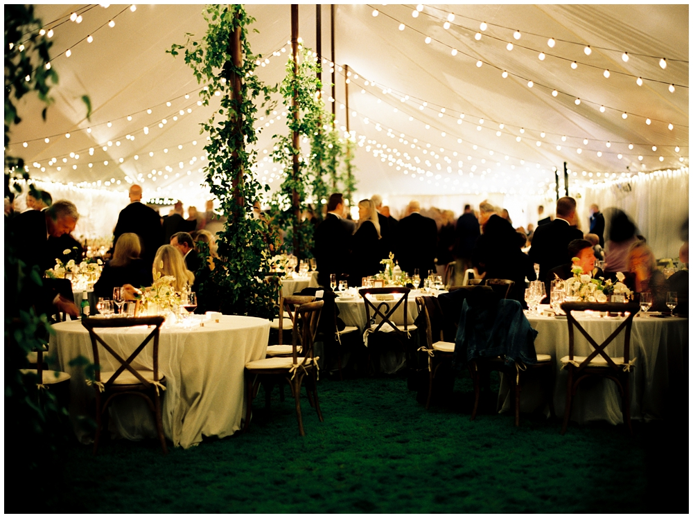 Tent lit up after dark during the reception