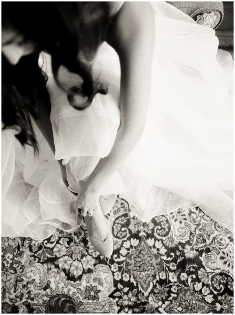 Bride getting ready, putting shoes on