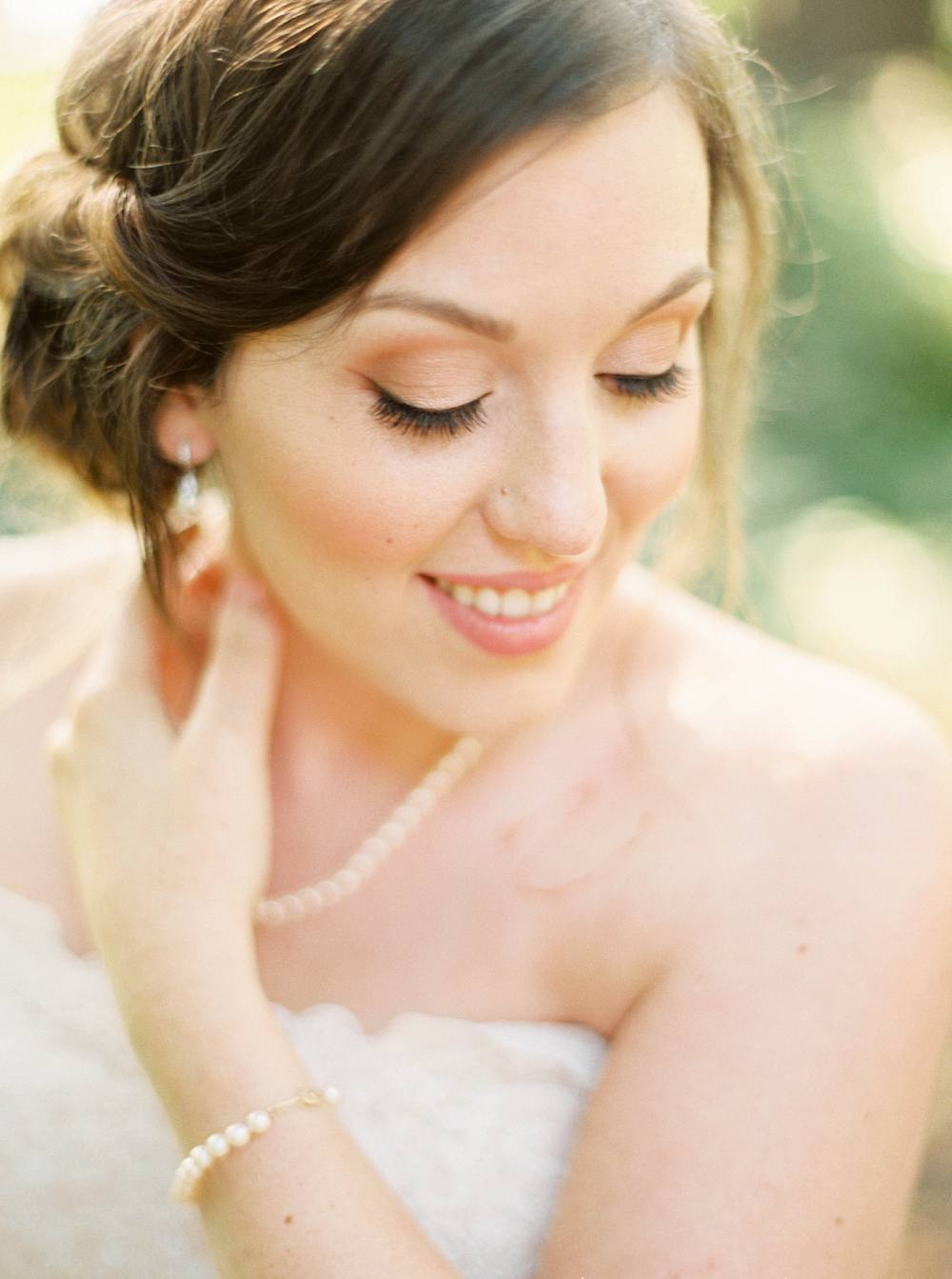 Close-up of bride smiling in beautiful golden light.