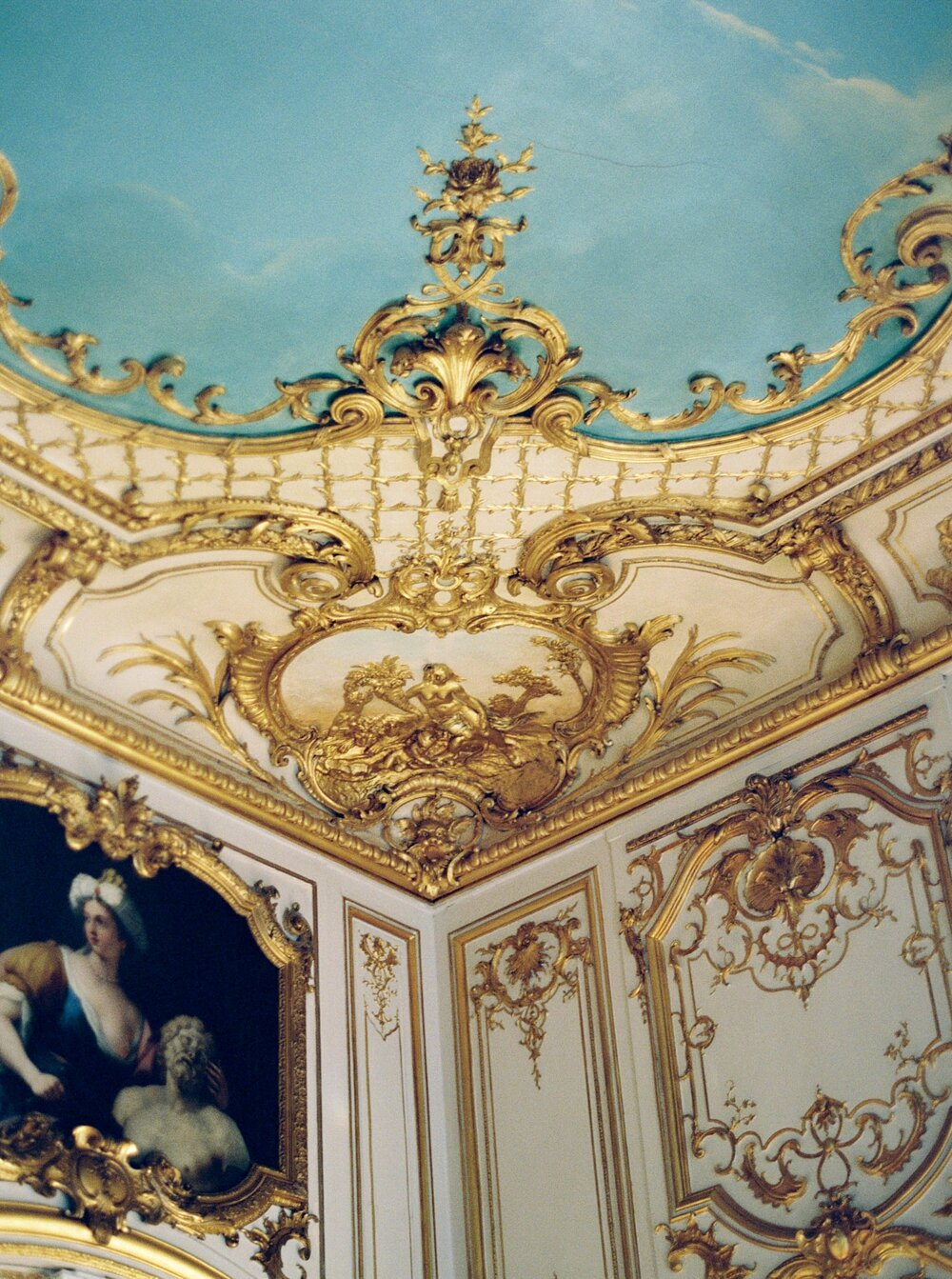 ceiling and wall details in the corner of the ballroom at the Hotel Le Marois in Paris, France