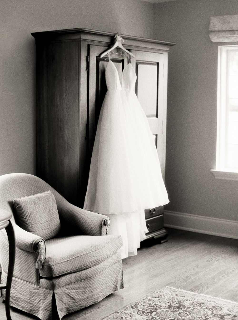 Wedding Gown hanging on the wardrobe before she puts it on, black and white image