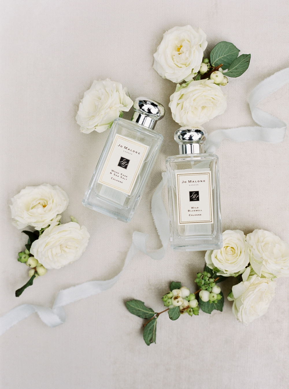 bride and groom's signature Jo Malone Scents styled with and flowers