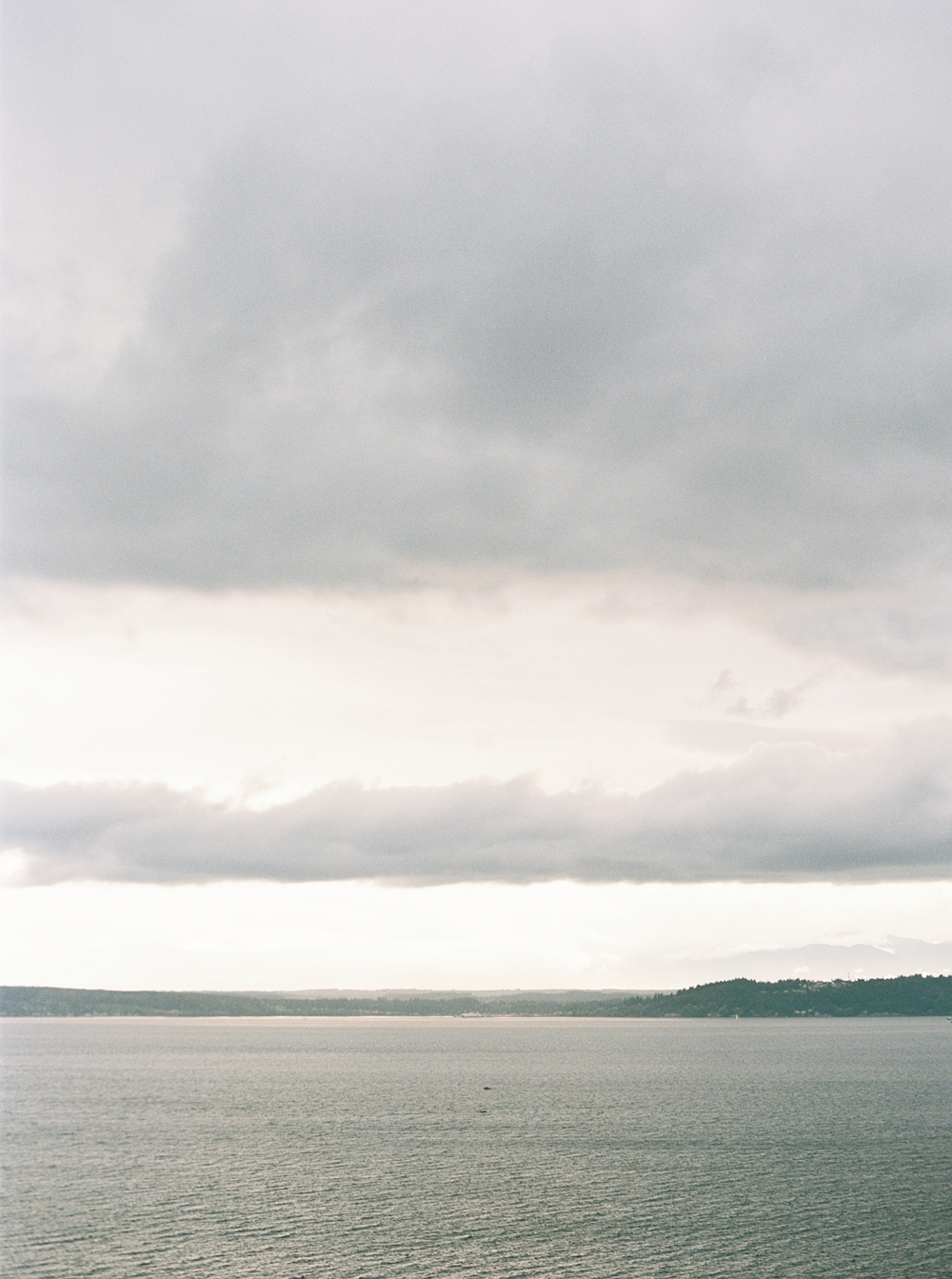 view of the puget sound just before the reception was set to start, grey skies due to cloud cover